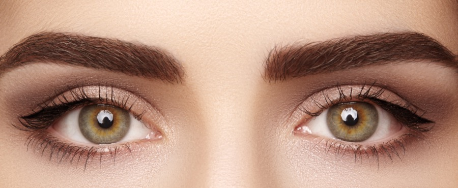 Close-up macro of beautiful female eye with perfect shape eyebrows. Clean skin, fashion naturel make-up. Good vision